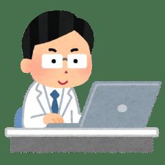 ノートPCを操作するドクター